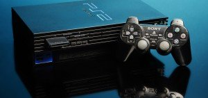 An angled PS2 with its controller. Shot on a blue background in the studio with studio lighting.