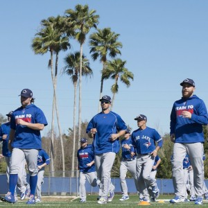 Toronto Blue Jays players including R.A. Dickey (left) and Russell Martin (right) warm up at spring training in Dunedin, Fla. on Sunday February 28, 2016. (Frank Gunn/CP)