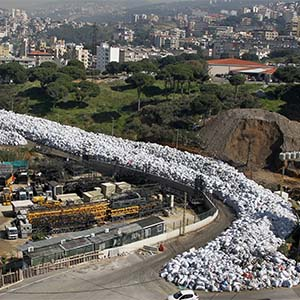 A general view of waste piled up along a street in the northern Beirut suburb of Al Fanar, Lebanon, 26 February 2016. The Lebanese cabinet reportedly canceled plans to export the garbage to Russia, causing the waste crisis to return to its starting point. The crisis led to the eruption of mass protests in summer 2015 which were organized by activist groups demanding the government to find a solution as well as to solve other problems. (Nabil Mounzer/EPA)