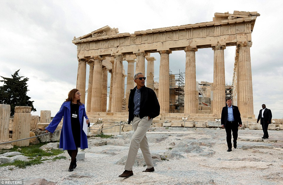 Barack Obama was shown around the Acropolis in Athens today by Eleni Banou (left) an antiquities expert from the Greek Culture Ministry, on his last trip abroad as US President. Later he will travel to Germany, the economic powerhouse of Europe