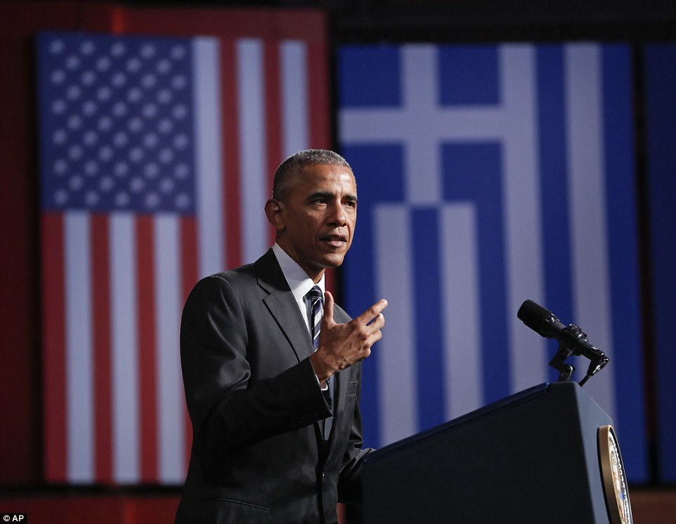 President Obama, standing in front of American and Greek flags, said: 'As long as we retain our faith in democracy, our faith in the people, then our future will be OK'