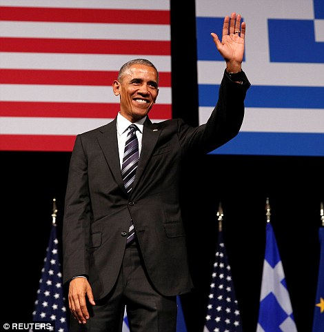 Obama waves and smiles