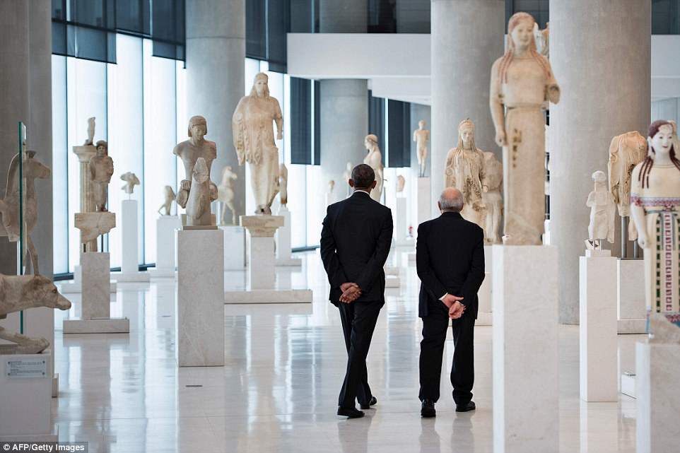 Obama (pictured left) was shown around the Acropolis Museum by its director, Professor Dimitrios Pandermalis (right). Obama's visit to the 'cradle of civilization' is his last foreign trip as President